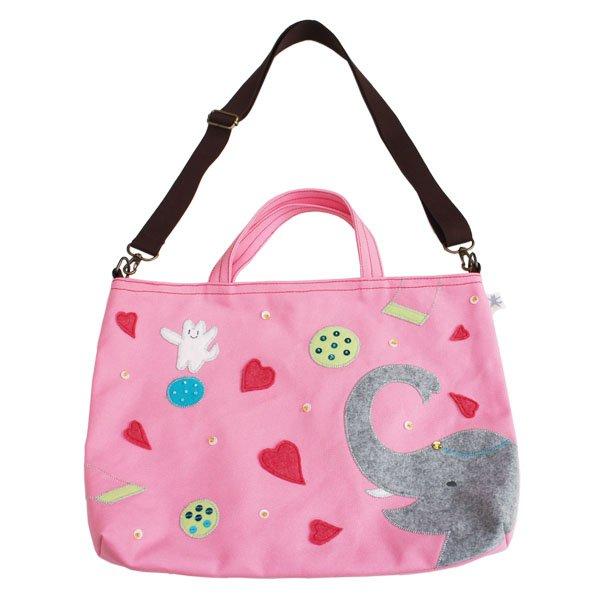 ピンクの帆布のレッスンバッグ